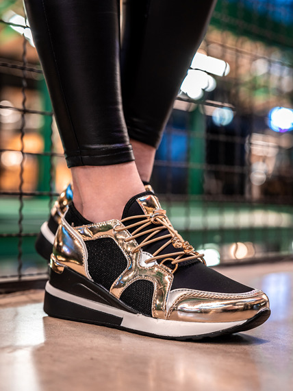 Black and gold light sneaker shoes